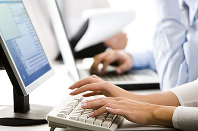 image of a person on a computer getting an insurance quote