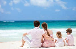 image of family sitting on a beach
