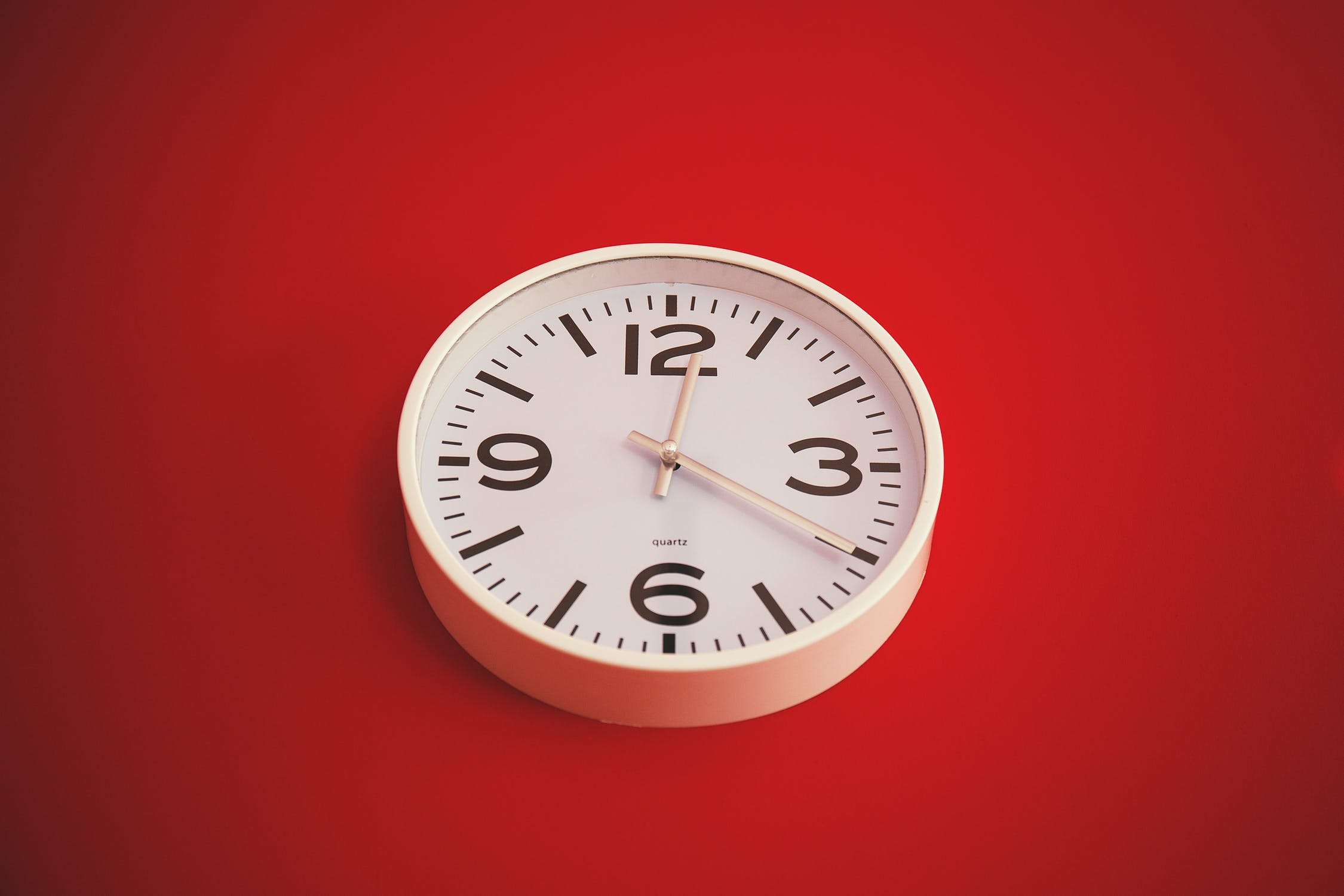 image of clock on red wall